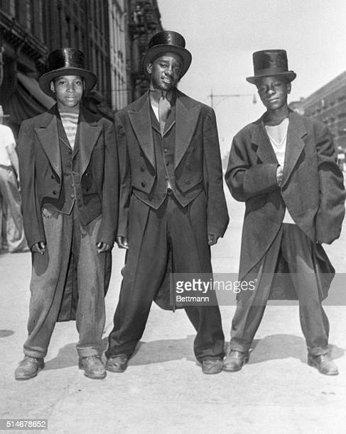 Walker Roberts Henry Campbell and Morris Jackson show off their new 'zoot suits' tuxedos looted from a formalwear shop during the Harlem riot of...