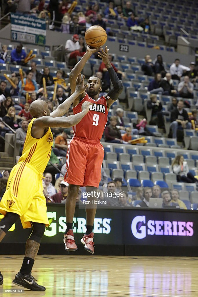 Walker Russell Jr. #11 of the Fort Wayne Mad Ants guards Sheldon Mack #9 of the Maine Red Claws at Allen County Memorial Coliseum on November 25, 2010 in Fort Wayne, Indiana.