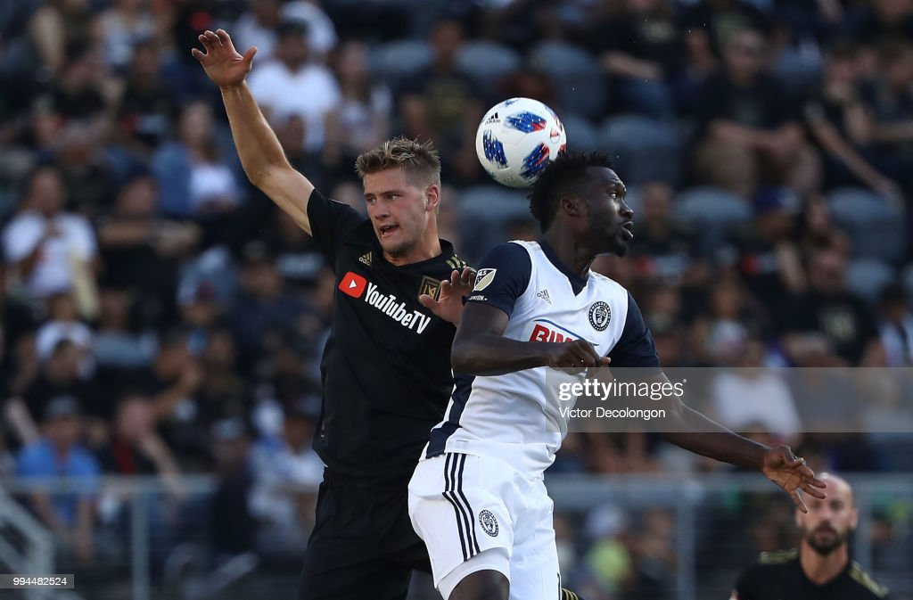 Walker Zimmerman #25 of Los Angeles FC and C.J. Sapong #17 of Philadelphia Union vie for the ball in the second half of the MLS match at Banc of California Stadium on June 30, 2018 in Los Angeles, California. Los Angeles FC defeated the Philadelphia Union 4-1.