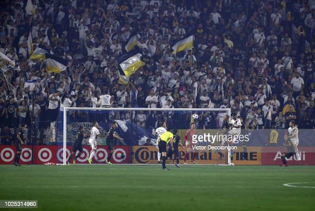 Walker Zimmerman of Los Angeles FC and Ola Kamara of Los Angeles Galaxy vie for the ball into the box during the first half of the MLS match at...