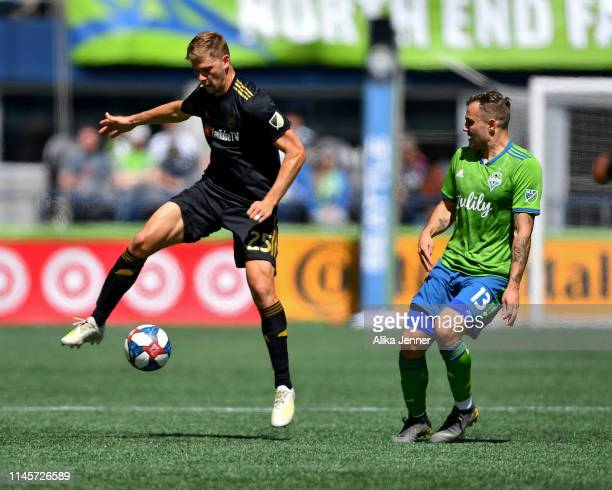 Walker Zimmerman of the Los Angeles FC takes control of the ball while Jordan Morris of the Seattle Sounders watches during the second half of the...