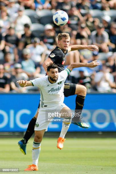 Walker Zimmerman of the Los Angeles Football Club and Diego Valeri of the Portland Timbers battle for control of the ball at Banc of California...