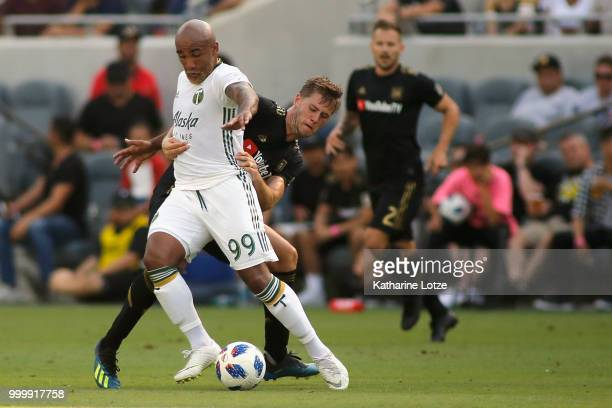 Walker Zimmerman of the Los Angeles Football Club grabs Samuel Armenteros of the Portland Timbers at Banc of California Stadium on July 15 2018 in...