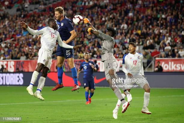 Walker Zimmerman of the United States heads the ball past Edgar Gondola and goalkeeper Eddie Roberts of Panama to score a goal during the second half...