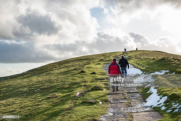 Walkers ascending to the summit of Mam Tor, Derbyshire