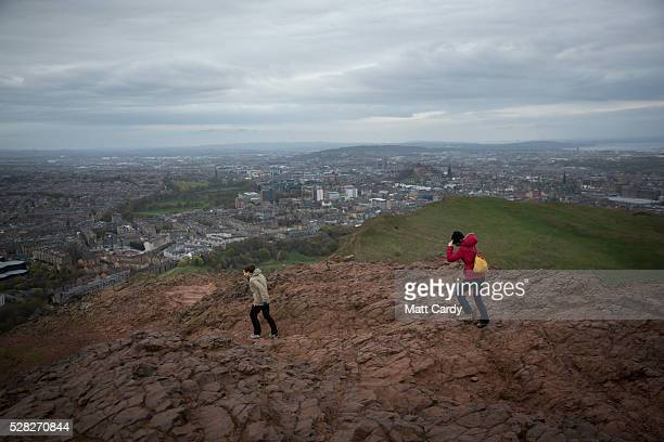 Walkers brave the winds at Arthur's Seat in Holyrood Park on May 4 2016 in Edinburgh Scotland As campaigning for the Holyrood election enters its...