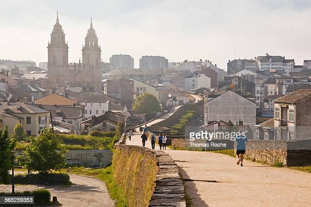 Walkers enjoying the Roman wall in Lugo