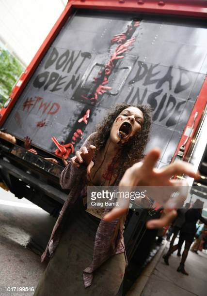 Walkers from The Walking Dead roam outside Hammerstein Ballroom during New York Comic Con on October 7 2018 in New York City