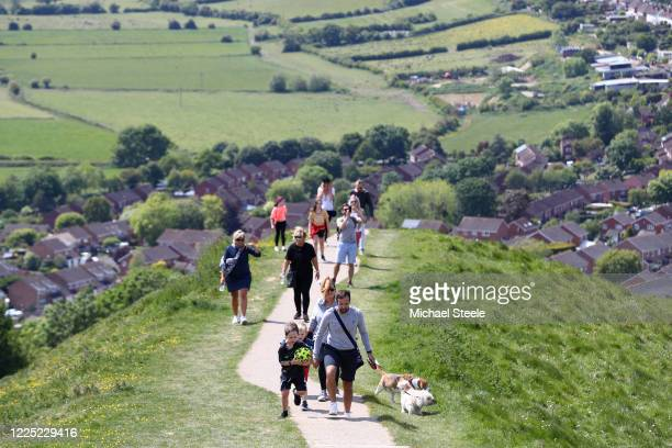 Walkers head up towards Glastonbury Tor on May 16, 2020 in Glastonbury, North Somerset, England. The prime minister announced the general contours of...