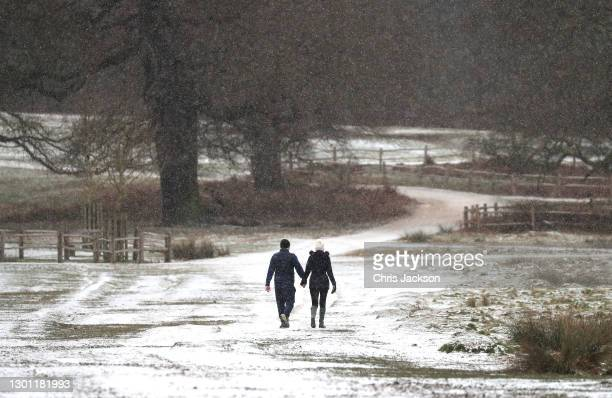 Walkers in the snow in Richmond Park on February 09, 2021 in London, England. A Met Office Weather Warning remains in place for many parts of the UK.