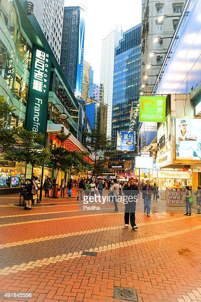 walkers in the street center hong kong, china - pavliha stock photos and pictures