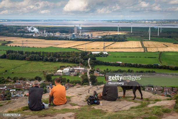 Walkers look out from Helsby Hill across the Mersey Estuary towards the CF Industries Holdings Inc. Fertilizer manufacturing complex, which is being...