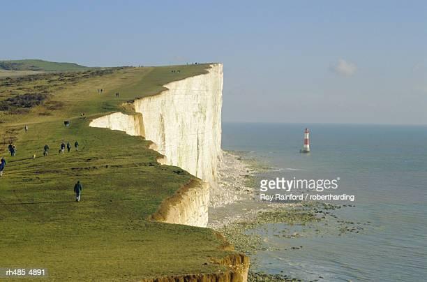 Walkers on cliff top, Beachy Head, Sussex, England, UK