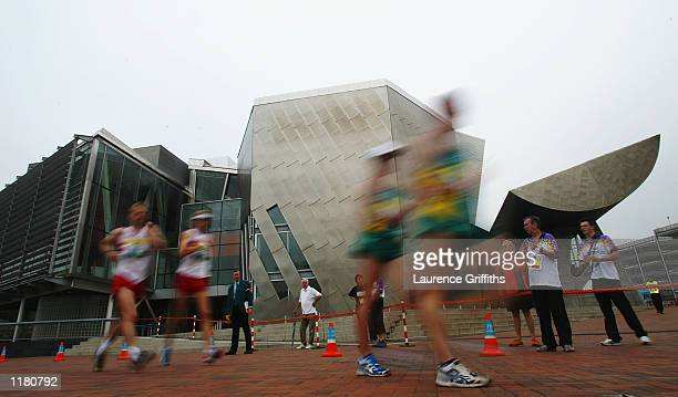 Walkers pass the Lowrey Centre during the Mens 50 kilometers walk in Salford Quays in Manchester England on JULY 30 2002
