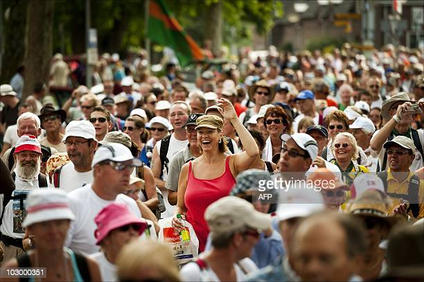 Walkers pass the small village Elst during the first day of the 94th annual International Four Days Marche in Nijmegen on July 20 2010 AFP PHOTO /...