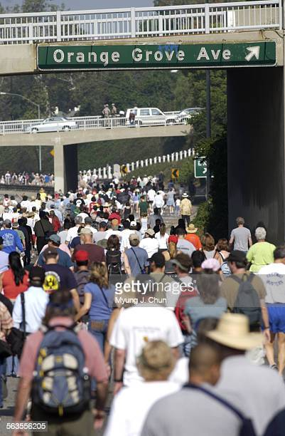 Walkers take their turn hiking an eight–mile section of the 110 Pasadena Freeway during Sunday's Arroyo Fest. The event opened the thoroughfare, also...