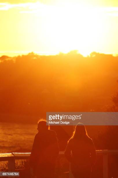 Walkers travel down Olivers Hill in Frankston as morning fog slowly clears during sunrise on June 19 2017 in Melbourne Australia