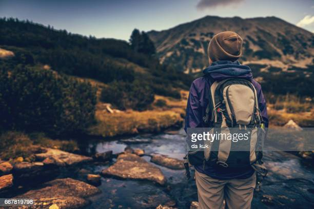walking alone in the mountains at sunset - pirin national park stock pictures, royalty-free photos & images