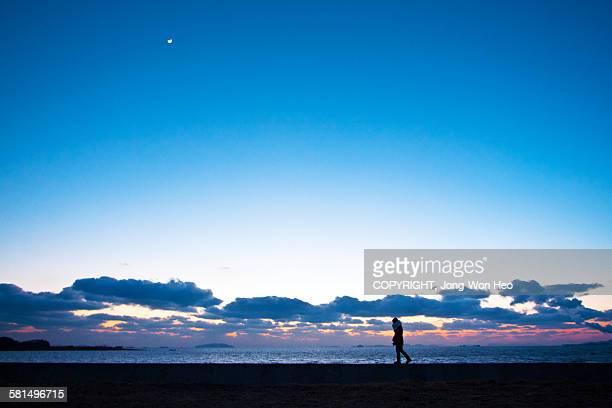 Walking alone under the moon