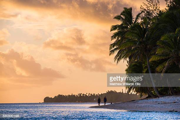 Walking along a tropical beach at sunset, Rarotonga, Cook Islands, South Pacific, Pacific