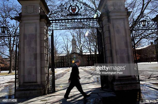 Walking along Nassau St in front of Nassau Hall on campus of Princeton University in Princeton NJ on March 12 2015