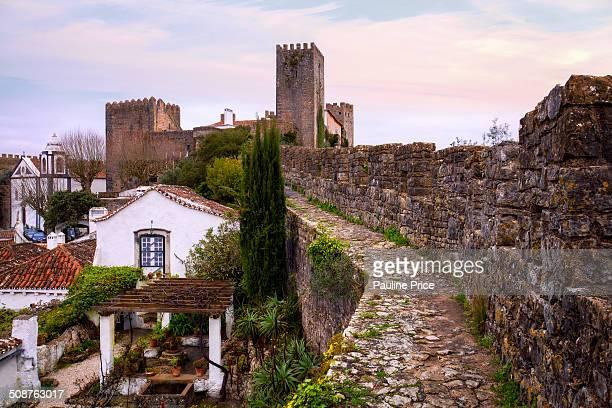 Walking Along the Castle Walls, Obidos, Portugal.