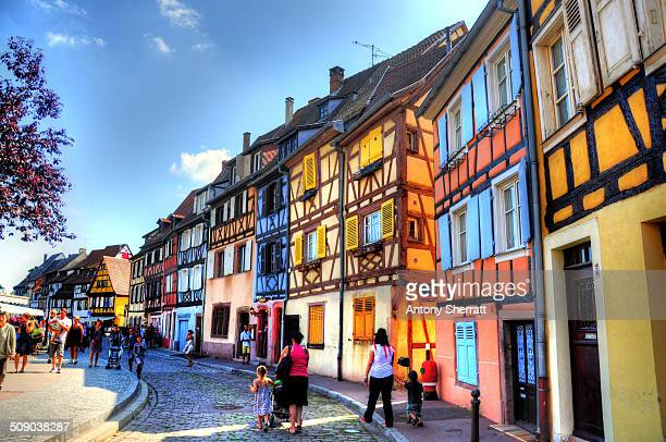 Walking along the river with colourful buildings in Colmar Alsace in France.