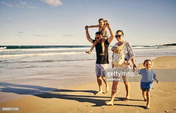 walking along to a day of fun - beach stock pictures, royalty-free photos & images