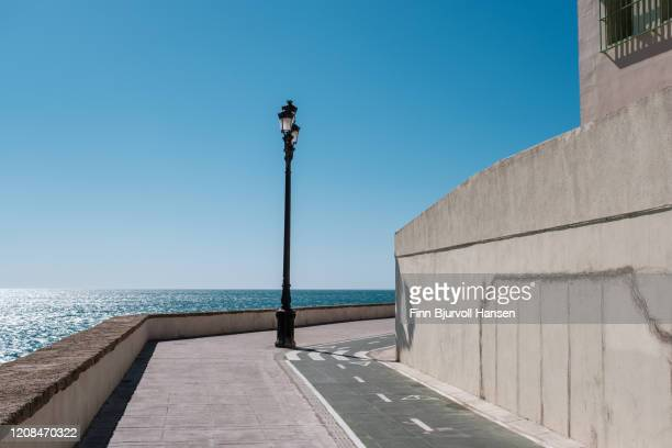 walking and bicycle pathway in cadiz spain - finn bjurvoll stock pictures, royalty-free photos & images
