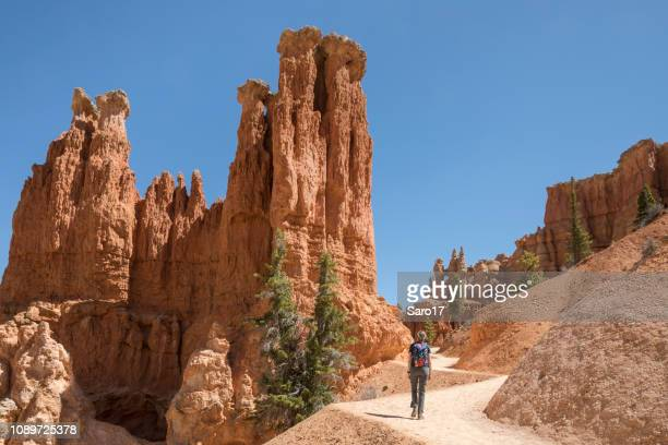 walking at bryce canyon, utah. - unesco world heritage site stock pictures, royalty-free photos & images