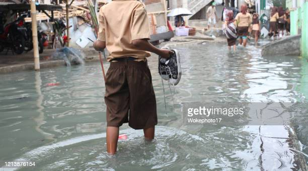 walking at flood water - flood stock pictures, royalty-free photos & images