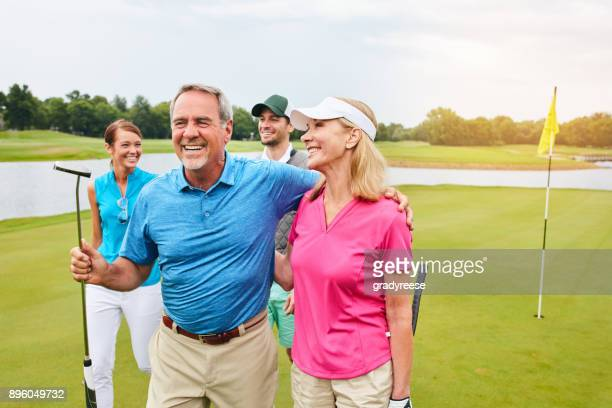 walking away as winners - golfer stock pictures, royalty-free photos & images