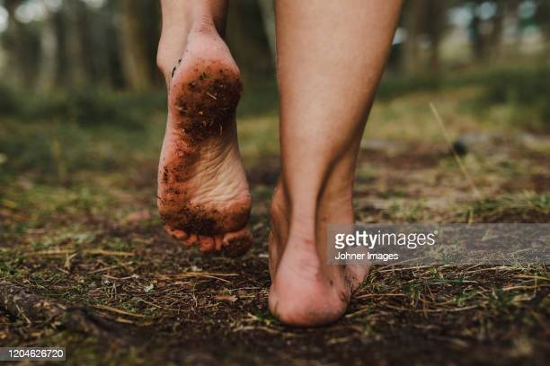 walking bare feet - barefoot stock pictures, royalty-free photos & images