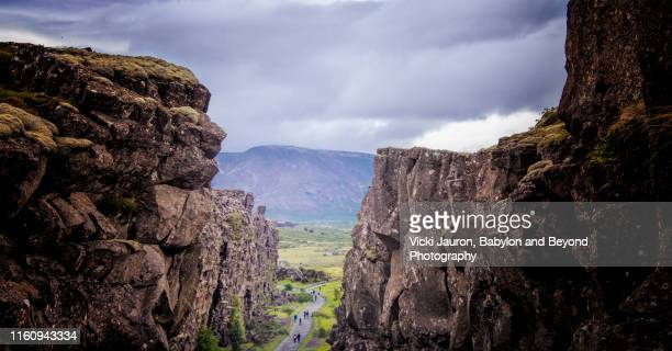 walking between the continents at thingvellir national park, iceland - thingvellir national park stock photos and pictures