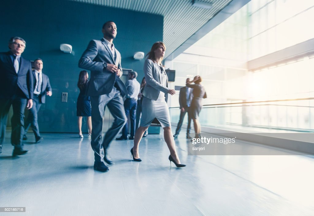 Walking business people : Stock Photo