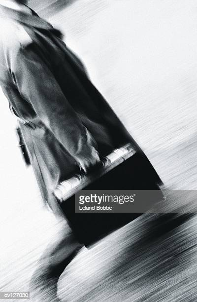 Walking businessman in overcoat