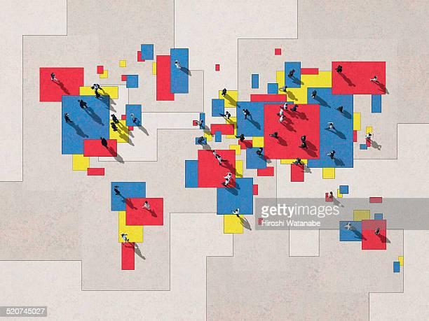 walking businessmen on the world map - affari internazionali foto e immagini stock