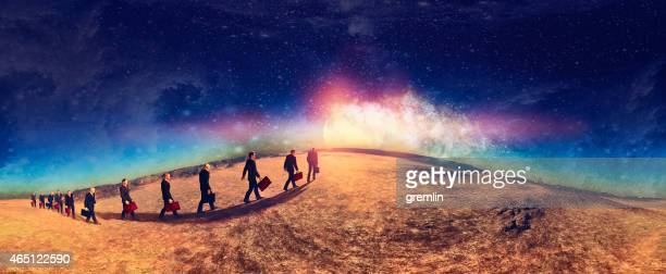 Walking businessmen planet surface with rising Moon