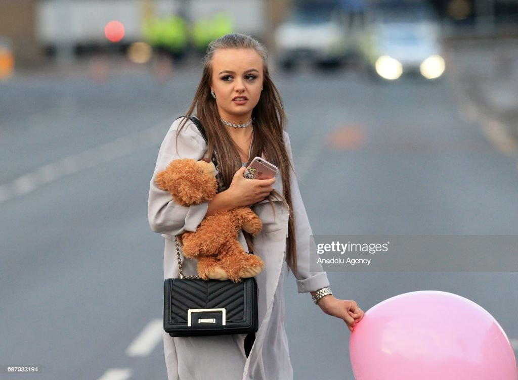 Walking casualties leave a nearby hotel that took in people from the Manchester Arena stadium in Manchester, United Kingdom on May 23, 2017. A large explosion was reported at the end of a concert by American singer Ariana Grande. So far, police have confirmed 20 dead and over fifty injured in the explosion, now thought to be terrorist-related.