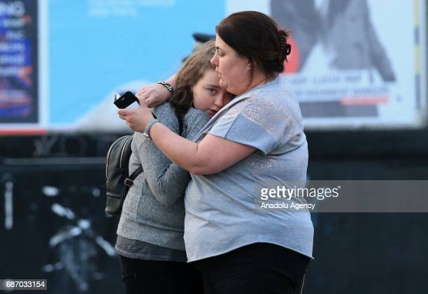Walking casualties Vikki Baker and her thirteen year old daughter Charlotte hug outside the Manchester Arena stadium in Manchester United Kingdom on...