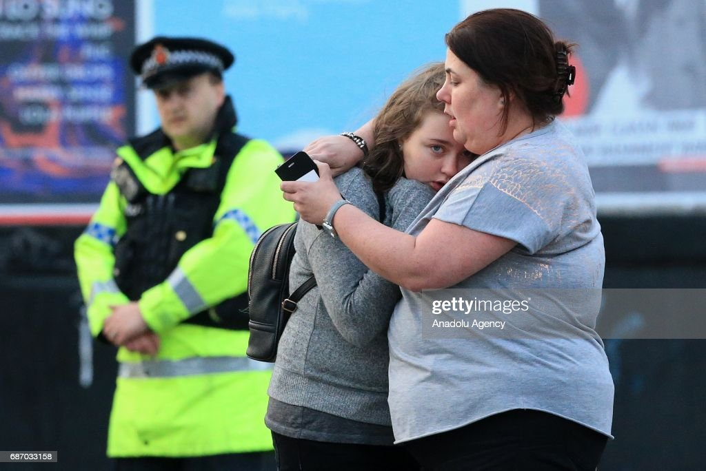 Walking casualties Vikki Baker and her thirteen year old daughter Charlotte hug outside the Manchester Arena stadium in Manchester, United Kingdom on May 23, 2017. A large explosion was reported at the end of a concert by American singer Ariana Grande. So far, police have confirmed 20 dead and over fifty injured in the explosion, now thought to be terrorist-related.