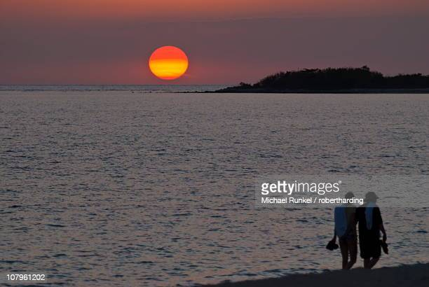 Walking couple at sunset, Playa Ancon, Trinidad, Cuba, West Indies, Caribbean, Central America