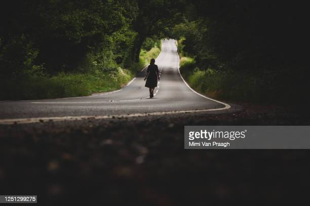 walking down an empty country road - murder stock pictures, royalty-free photos & images