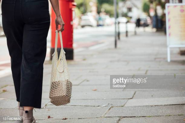 walking down the street - low section stock pictures, royalty-free photos & images