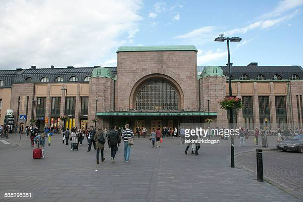 walking front of old train station building at helsinki finland