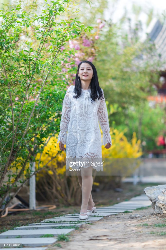 Walking Girl in Springtime : Stock Photo