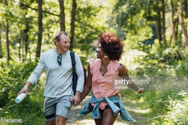 walking hand in hand - couple relationship stock pictures, royalty-free photos & images