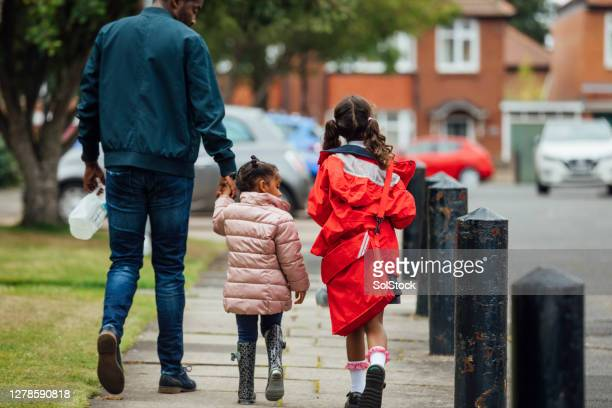 walking home from school - walking stock pictures, royalty-free photos & images