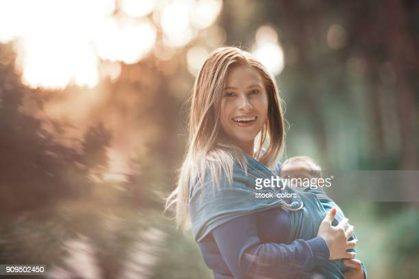 walking in beautiful day with her daughter - arm sling stock pictures, royalty-free photos & images