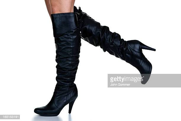 walking in  boots - black boot stock pictures, royalty-free photos & images